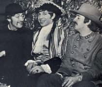 John as a parson, Paul as a Confederate Army officer, and Georgie Fame (center), at birthday party.