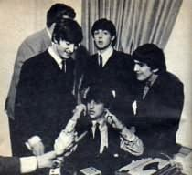 The Beatles messing about on the phone