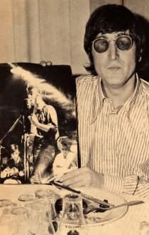 John Lennon and a photo of himself