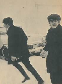 Ringo Starr and John Lennon in the snow near a car